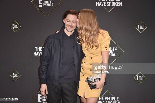Tom Payne and Jennifer Akerman attend 2019 E People's Choice Awards Arrivals at The Barker Hanger on November 10 2019 in Santa Monica California