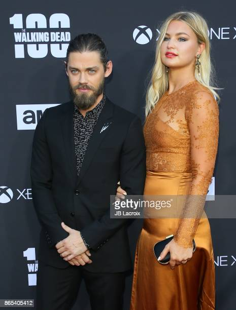 Tom Payne and Jennifer Akerman attend the 100th episode celebration off 'The Walking Dead' at The Greek Theatre on October 22 2017 in Los Angeles...