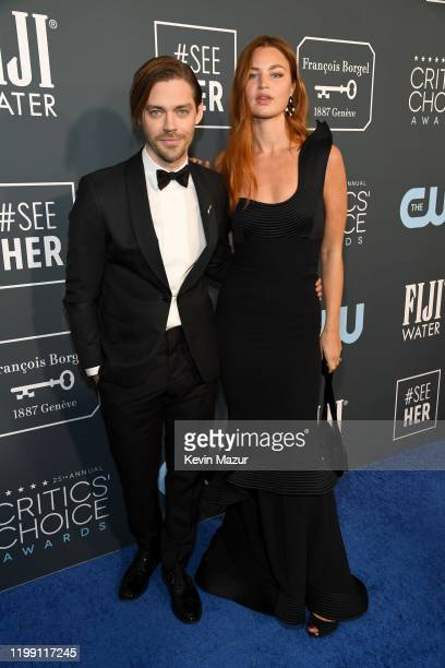 Tom Payne and Jennifer Akerman attend the 25th Annual Critics' Choice Awards at Barker Hangar on January 12 2020 in Santa Monica California