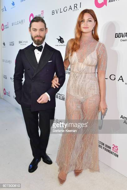 Tom Payne and Jennifer Akerman attend the 26th annual Elton John AIDS Foundation Academy Awards Viewing Party sponsored by Bulgari celebrating EJAF...