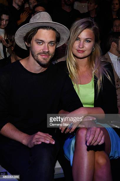 Tom Payne and Jennifer Akerman attend the 'Designer for Tomorrow' by Peek Cloppenburg and Fashion ID show during the MercedesBenz Fashion Week Berlin...