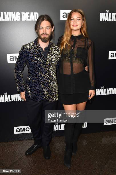 Tom Payne and Jennifer Akerman attend the Premiere of AMC's The Walking Dead Season 9 at DGA Theater on September 27 2018 in Los Angeles California