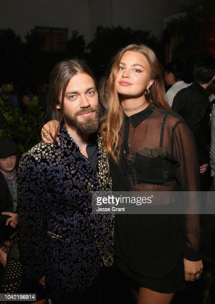 Tom Payne and Jennifer Akerman attend The Walking Dead Premiere and After Party on September 27 2018 in Los Angeles California