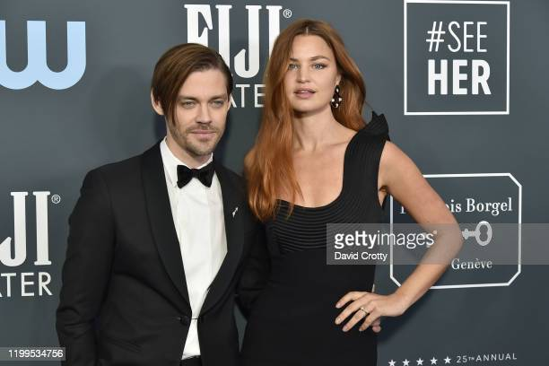 Tom Payne and Jennifer Akerman during the arrivals for the 25th Annual Critics' Choice Awards at Barker Hangar on January 12 2020 in Santa Monica CA