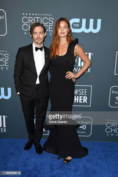 Tom Payne and Jennifer Åkerman attend the 25th Annual Critics' Choice Awards at Barker Hangar on January 12 2020 in Santa Monica California