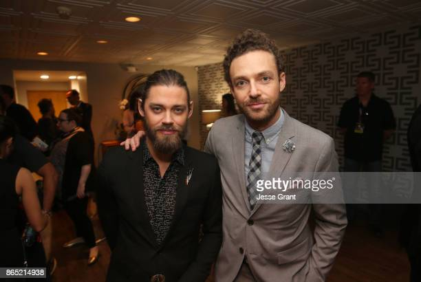 Tom Payne and Ross Marquand attend The Walking Dead 100th Episode Premiere and Party on October 22 2017 in Los Angeles California