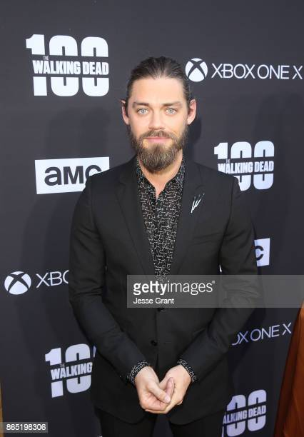Tom Payne arrives at The Walking Dead 100th Episode Premiere and Party on October 22 2017 in Los Angeles California