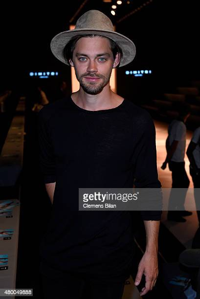 Tom Payne attends the Dimitri show during the MercedesBenz Fashion Week Berlin Spring/Summer 2016 at Brandenburg Gate on July 9 2015 in Berlin Germany