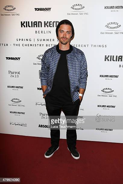 Tom Payne attends the Kilian Kerner show during the MercedesBenz Fashion Week Berlin Spring/Summer 2016 at on July 8 2015 in Berlin Germany