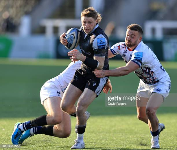 Tom Penny of Newcastle Falcons is tackled by Andy Uren during the Gallagher Premiership Rugby match between Newcastle Falcons and Bristol Bears at...