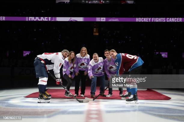 Tom Petersen drops the ceremonial puck next to his wife Angie son Ben daughter Sarah Gabriel Landeskog of the Colorado Avalanche and Alex Ovechkin of...