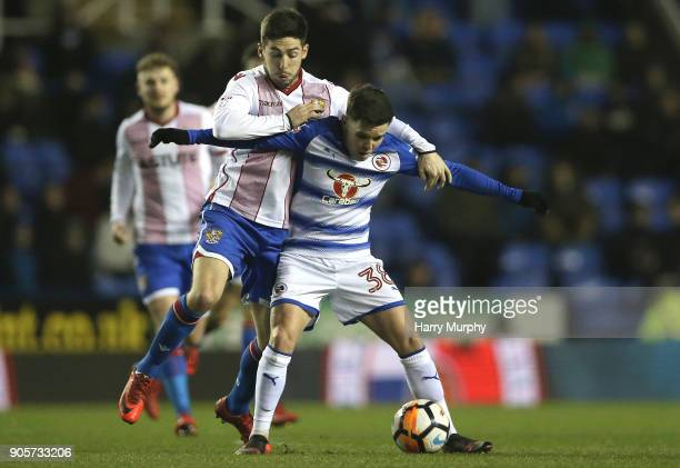 Tom Pett of Stevenage and Liam Kelly of Reading vie for the ball during the Emirates FA Cup Third Round Replay match between Reading and Stevenage at...