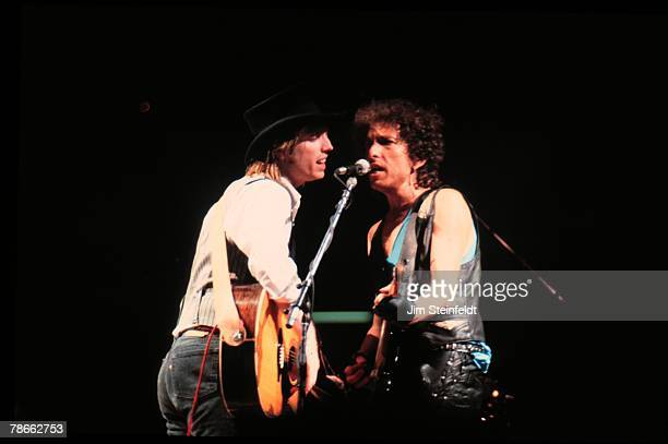 Tom Petty and Bob Dylan perform at the Hubert H Humphrey Metrodome during the Bob Dylan Grateful Dead Tom Petty and the Heartbreakers Tour in...