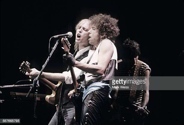 Tom Petty Bob Dylan and Ron Wood perform on stage United States 1986
