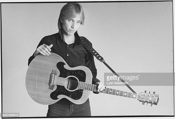 Tom Petty Holding His Guitar