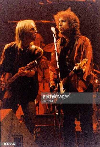Tom Petty of Tom Petty and The Heartbreakers joins Bob Dylan on stage during his concert at Wembley Arena on October 14th 1987 in London England