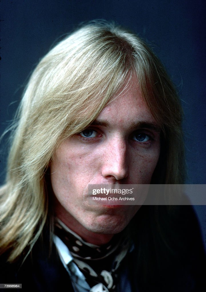 Tom Petty poses for a portrait backstage in August 1977 in Los Angeles, California.