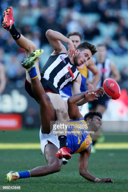 Tom Phillips of the Magpies and WIllie Rioli of the Eagles collide during the round 17 AFL match between the Collingwood Magpies and the West Coast...