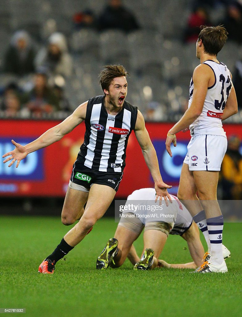 Tom Phillips of the Magpies celebrates a goal during the round 14 AFL match between the Collingwood Magpies and the Fremantle Dockers at Melbourne Cricket Ground on June 24, 2016 in Melbourne, Australia.