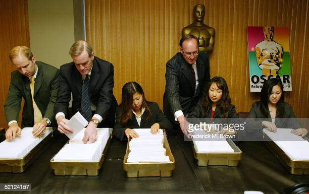 Tom Pierce, P. Gregory Garrison, Joyce Kim, Bradley J. Oltmanns, and Vivian Wu of PricewaterhouseCoopers' Academy Award Balloting Team, prepare...