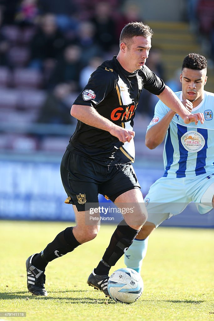 Tom Pope of Port Vale in action during the Sky Bet League One match between Coventry City and Port Vale at Sixfields Stadium on March 16, 2014 in Northampton, England.