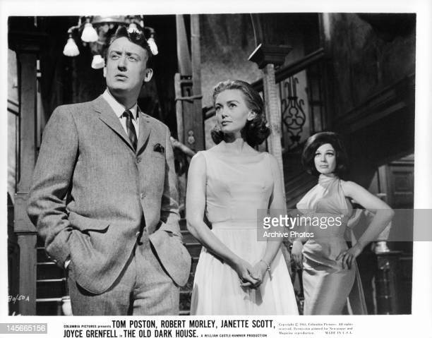 Tom Poston and Janette Scott standing together with Fenella Fielding behind them in a scene from the film 'The Old Dark House' 1963