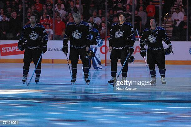 Tom Preissing Jack Johnson Alexander Frolov and Michael Cammalleri of the Los Angeles Kings stand during the national anthem before their game...