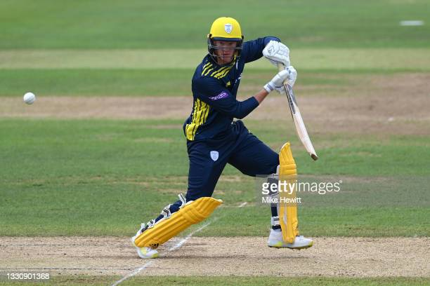 Tom Prest of Hampshire hits out during the Royal London Cup match between Hampshire and Sussex at Ageas Bowl on July 27, 2021 in Southampton, England.