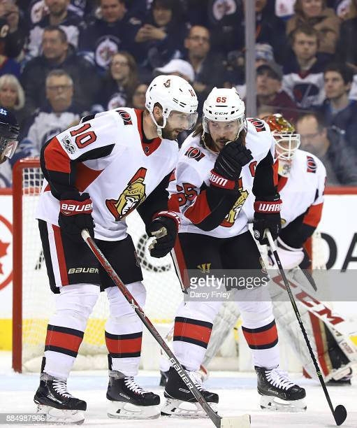 Tom Pyatt and Erik Karlsson of the Ottawa Senators discuss strategy during first period action against the Winnipeg Jets at the Bell MTS Place on...