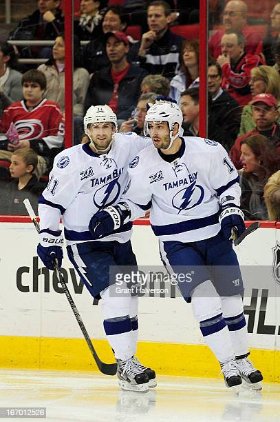 Tom Pyatt and Teddy Purcell of the Tampa Bay Lightning celebrate after Purcell's goal against the Carolina Hurricanes during the second period at PNC...