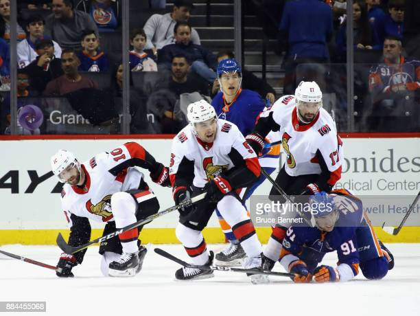 Tom Pyatt Cody Ceci and Nate Thompson of the Ottawa Senators skate against the New York Islanders at the Barclays Center on December 1 2017 in the...