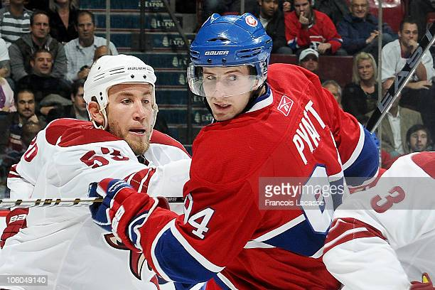 Tom Pyatt of the Montreal Canadiens and Derek Morris of the Phoenix Coyotes battle for position during the NHL game on October 25 2010 at the Bell...