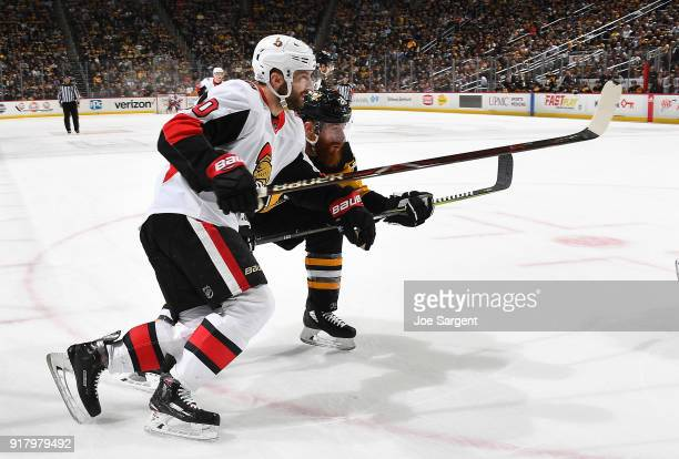 Tom Pyatt of the Ottawa Senators and Ian Cole of the Pittsburgh Penguins skate at PPG Paints Arena on February 13 2018 in Pittsburgh Pennsylvania