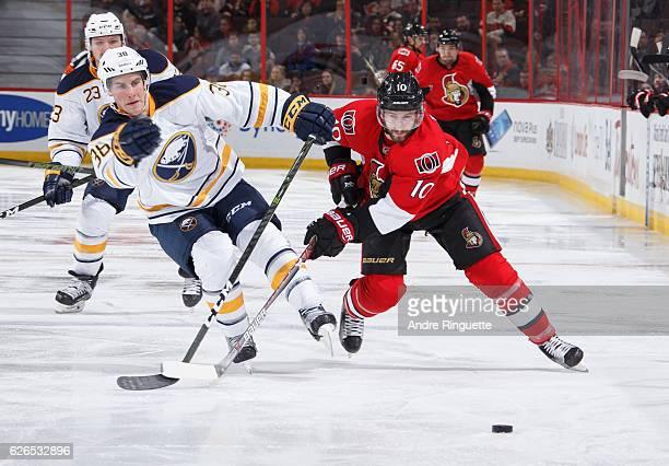 Tom Pyatt of the Ottawa Senators battles for position against Taylor Fedun of the Buffalo Sabres at Canadian Tire Centre on November 29 2016 in...