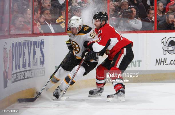 Tom Pyatt of the Ottawa Senators battles for position against Tim Schaller of the Boston Bruins in Game One of the Eastern Conference First Round...