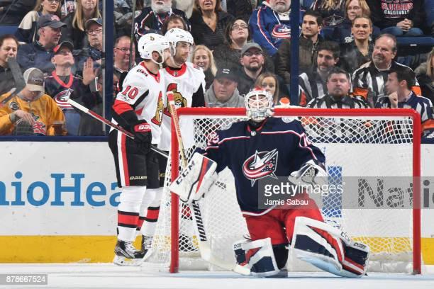 Tom Pyatt of the Ottawa Senators celebrates his first period goal with teammate Derick Brassard of the Ottawa Senators during a game against the...