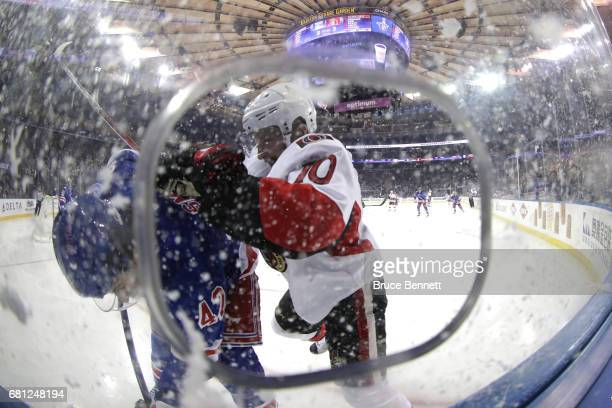 Tom Pyatt of the Ottawa Senators checks Brendan Smith of the New York Rangers during the third period in Game Six of the Eastern Conference Second...