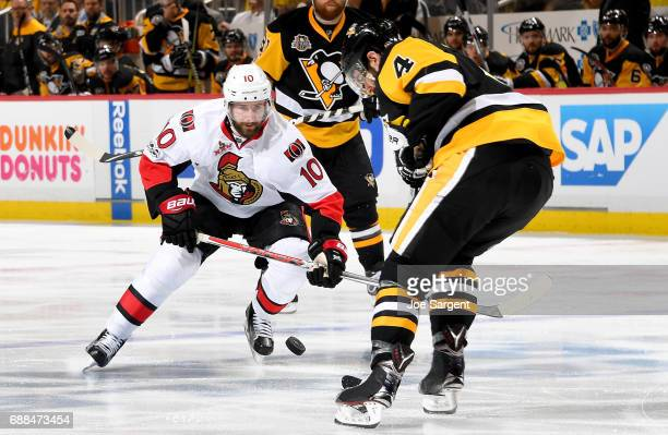 Tom Pyatt of the Ottawa Senators handles the puck against Justin Schultz of the Pittsburgh Penguins in Game Seven of the Eastern Conference Final...