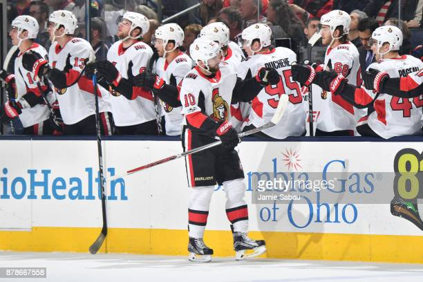 Tom Pyatt of the Ottawa Senators highfives his teammates after scoring a goal during the first period of a game against the Columbus Blue Jackets on...