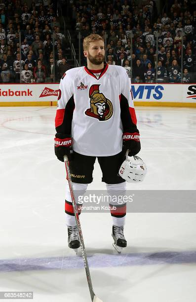 Tom Pyatt of the Ottawa Senators looks on during the singing of 'O Canada' prior to puck drop against the Winnipeg Jets at the MTS Centre on April 1...