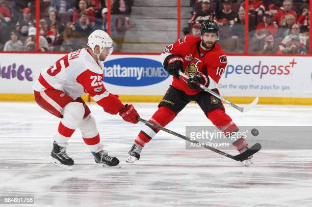 Tom Pyatt of the Ottawa Senators passes the puck up ice against Mike Green of the Detroit Red Wings at Canadian Tire Centre on April 4 2017 in Ottawa...