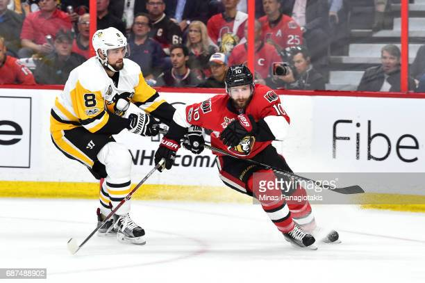 Tom Pyatt of the Ottawa Senators skates for the puck against Brian Dumoulin of the Pittsburgh Penguins during the first period in Game Six of the...