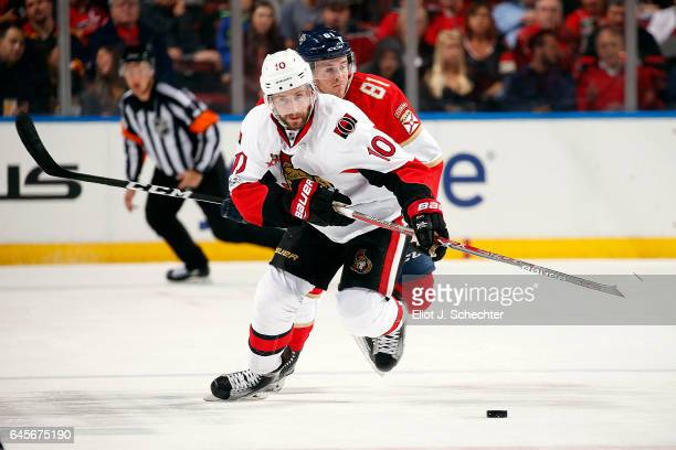 Tom Pyatt of the Ottawa Senators skates with the puck against Jonathan Marchessault of the Florida Panthers at the BBT Center on February 26 2017 in...