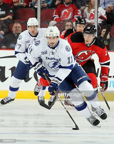 Tom Pyatt of the Tampa Bay Lightning in action against the New Jersey Devils at the Prudential Center on February 7 2013 in Newark New Jersey The...