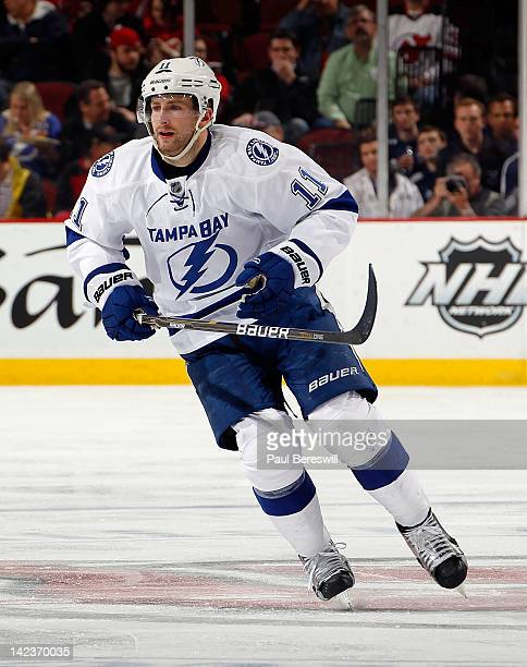 Tom Pyatt of the Tampa Bay Lightning skates during an NHL hockey game against the New Jersey Devils at Prudential Center on March 29 2012 in Newark...