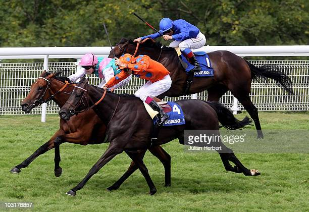 Tom Queally and Midday lead the Cristophe Soumillon ridden Stacelita and the Frankie Dettori partnered Antara home to land The Blue Square Nassau...