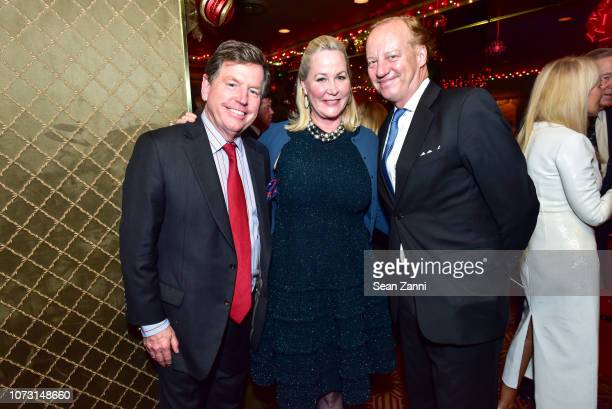 Tom Quick Sara Dodd and Will Denton attend George Farias Anne Jay McInerney Host A Holiday Party at The Doubles Club on December 13 2018 in New York...
