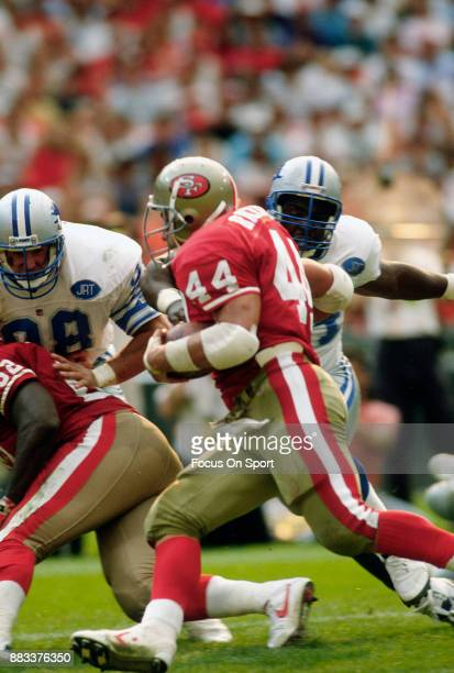 Tom Rathman of the San Francisco 49ers carries the ball against the Detroit Lions during the an NFL football game October 20 1991 at Candlestick Park...