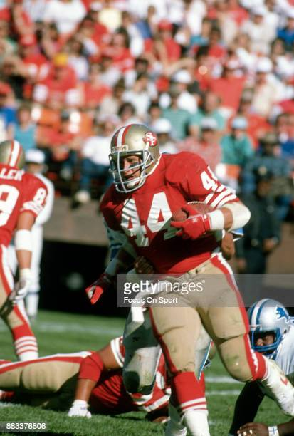 Tom Rathman of the San Francisco 49ers carries the ball against the Detroit Lions during the an NFL football game October 2 1988 at Candlestick Park...