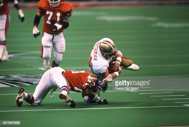 Tom Rathman of the San Francisco 49ers gets tackled by Steve Atwater of the Denver Broncos during Super Bowl XXIV on January 28 1990 at the Super...